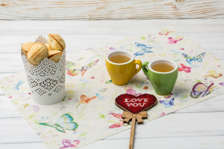 homemade cookies shaped nuts with cream boiled condensed milk on white background. Tea with sweets. I love you. Valentine's Day Imagens