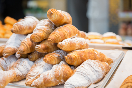 Tasty fresh croissants and rolls on a counter in shop or supermarket Stock fotó