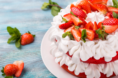 Strawberry and cream sponge cake. Homemade summer dessert on blue wooden table. Sweets for loved ones