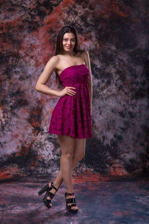 Attractive young woman studio portrait on marble colored background. Model test