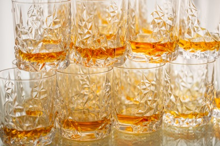Many Glasses with whiskey at a buffet table or reception Stock Photo