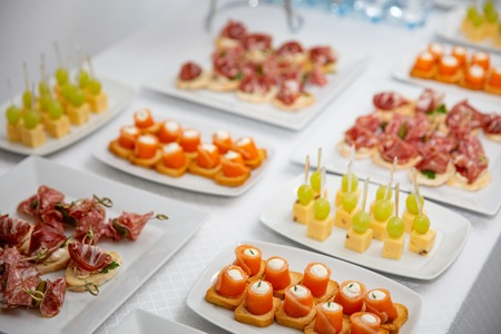 the buffet at the reception. Assortment of canapes. Banquet service. catering food, snacks with salmon