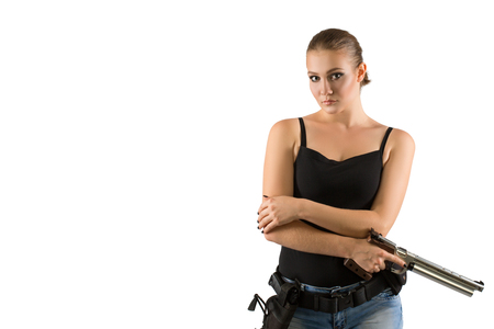 Young beautiful woman holding a sport gun isolated on white background. Copy space