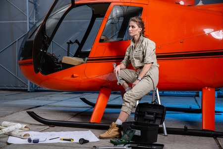 female helicopter mechanic at work. gender equality. feminism Banque d'images - 107592495