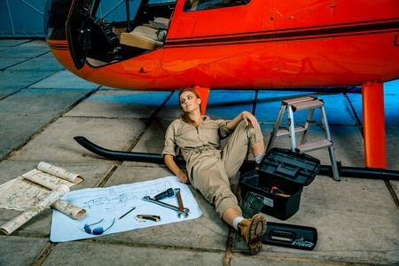 female helicopter technician tired at work. gender equality. feminism Banque d'images - 107592503