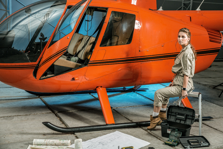 female helicopter mechanic at work. gender equality. feminism Banque d'images - 107592547