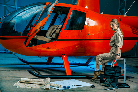 female helicopter mechanic at work. gender equality. feminism Banque d'images - 107592562