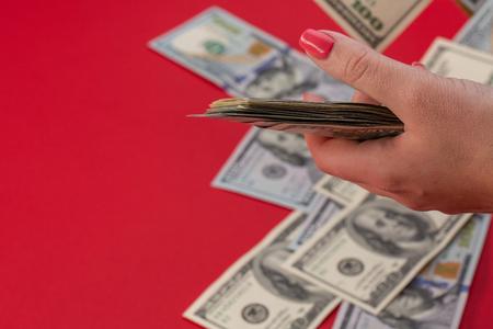 Female hand holding pack of money, millionaire. 版權商用圖片