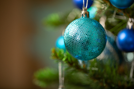 Blue Christmas ball on Christmas tree. New Year concept.