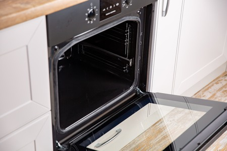 New electric open oven in white modern kitchen Imagens