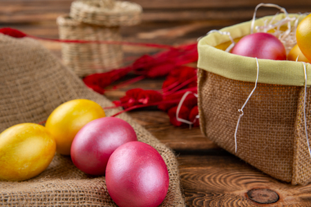 Easter eggs on a sackcloth and wooden background. Happy easter Bright multicolored shiny easter eggs. Background with easter eggs. Place for text Stock Photo
