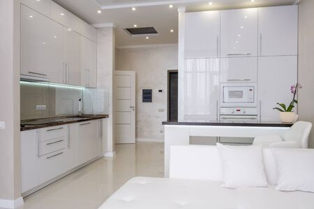 Interior of White modern kitchen in a house with a beautiful design