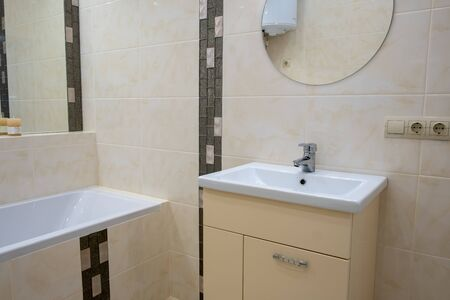 Interior of bathroom with sink basin faucet and mirror