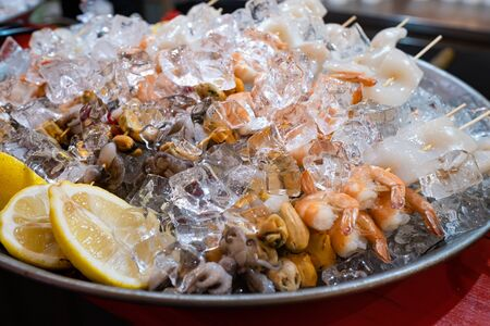 An extraordinary plate French oysters, shrimps, kebabs from Mixed Cold Seafood with lemon, and Ice