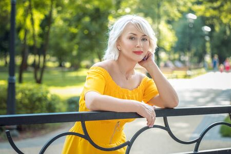 Portrait of beautiful middle aged blond 40-year-old woman