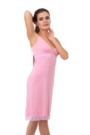 Seductive brunette woman standing in nightie isolated