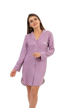 Happy girl in pajamas with polka dots isolated Фото со стока