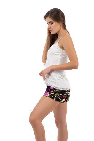 Young pretty brunette woman wearing pajamas isolated Фото со стока