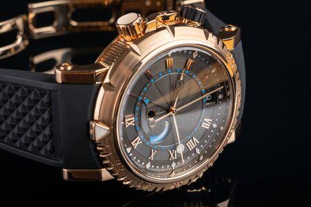 Close up view of nice mans wrist watch on black Фото со стока
