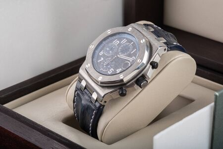 Wrist watch packed in open wooden box. gift for a man or businessman