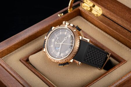 Wrist watch packed in open wooden box