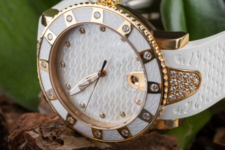 Womens white watch with white dial, leather strap with rhinestones.