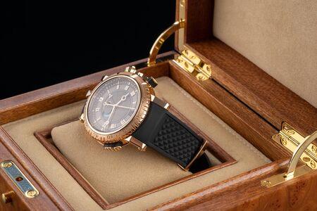 Wrist watch packed in open wooden box.