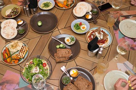 Different meals for the guests on the restaurant table.
