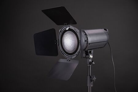 Professional led lamp or flash with Fresnel lens on black