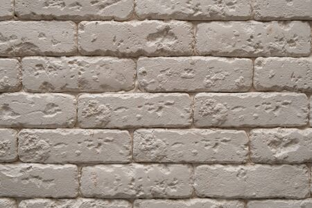 A white or beige brick wall
