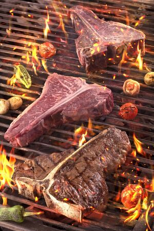 Different roasting Meat and vegetables char-grilled over flame.