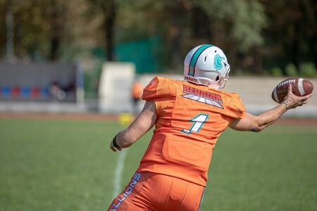 The back of A young, football player about to catch the ball. american football competitions Stallions Kyiv - Hurricanes Minsk 08.09.2019