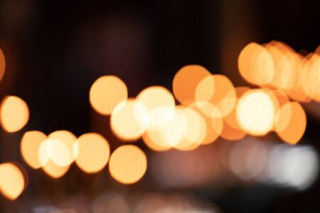 The Dark Abstract Gold bokeh sparkle on black 스톡 콘텐츠