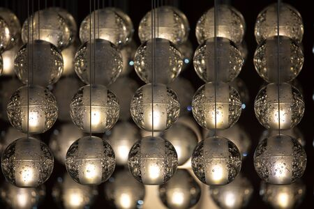 Crystal, transparent balls, sphere highlighted on a black