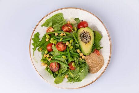 Healthy natural food. Salad with green vegetables, vitamins on the plate. asparagus beans avocado tomato salad