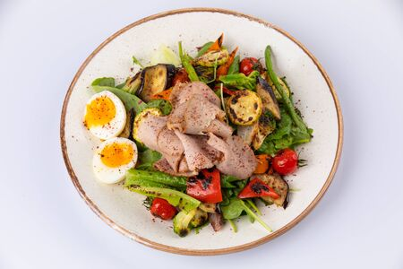 Salad with Strips of roast beef or meat, eggs and grilled vegetables 스톡 콘텐츠
