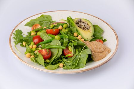 Healthy natural food. Salad with green vegetables, vitamins on the plate.