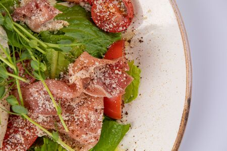 Salad with prosciutto arugula and tomatoes. Macro