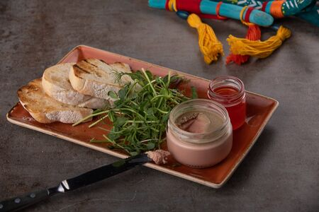 Fresh pate in glass jar with toasted bread on grey table Stok Fotoğraf