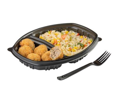 Thai cuisine mix spicy fried chicken nuggets with rice in a plastic bowl isolated on white background. Stock Photo