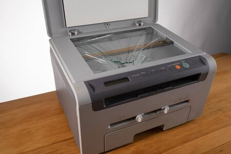 Broken old office printer and scanner. broken glass in the printer