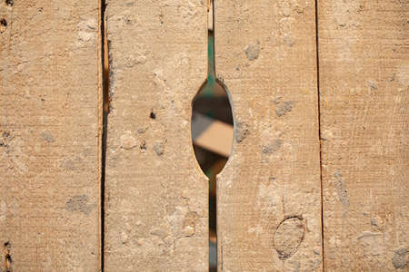 light brown wood texture, wooden board with a hole to pry Archivio Fotografico