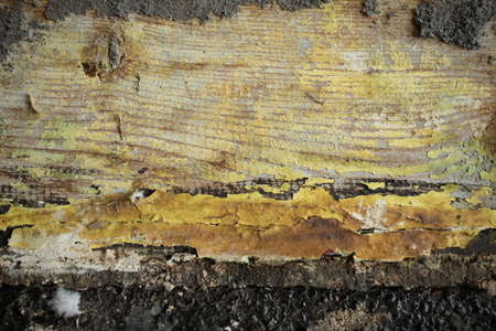 Paint peeling off the wall of an old wooden shed. Background for copy space