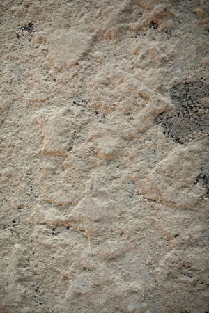 Cracked concrete texture background. Gray surface with cracks close up. A lot of pieces of splintered plaster. Abstract concept of split, dissent, disagreement, discord. Archivio Fotografico