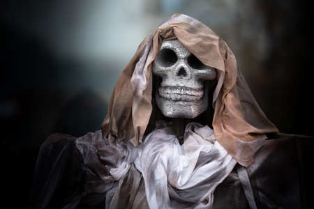 stone skull and cloth. Ghost decorations for Halloween, filter style. Archivio Fotografico