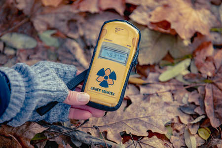 Checking radiation level with a personal dosimeter. Pripyat city in Chernobyl Exclusion Zone, Ukraine