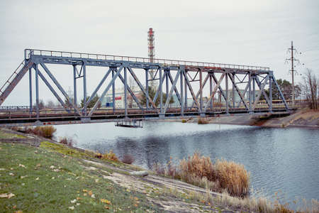 Railway bridge over the Pripyat river, Chernobyl. Metal structure, bridge supports. Bridge, years later, after the Chernobyl nuclear power plant.