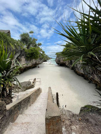 Stairs between rocks heading to a beach. Zanzibar. travel to an exotic country