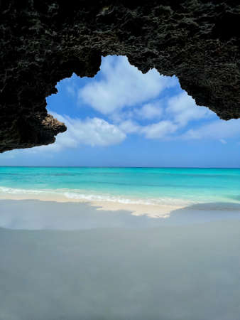 view from the cave at beach to the ocean in Zanzibar. traveling to an exotic country