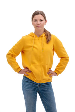 Young casual woman style isolated over white background. studio portrait of female model weared in yellow sweetshot 免版税图像